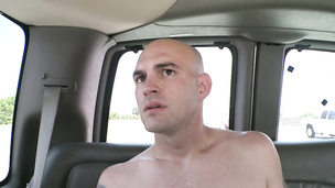 Tattooed bald twink shows his sexy body in the car