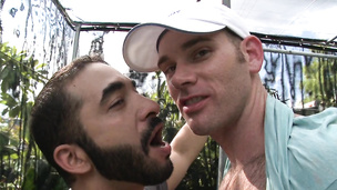 Bearded twink kisses and touches his lover in the garden