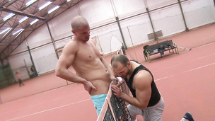 Muscular hunks have hardcore gay sex in the tennis court