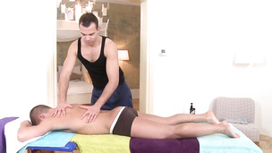 Oily stud enjoys getting sucked off by his horny masseuse