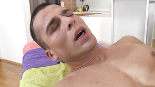 Oily stud gets his hairy ass plowed on massage table