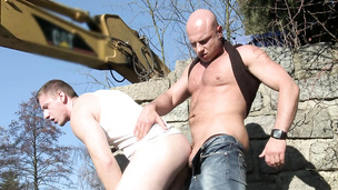 Two sexy construction workers have hardcore anal fuck session outdoors