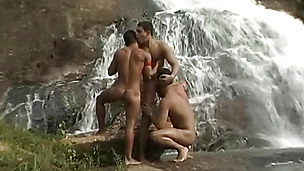 Daring twink friends love fucking and licking by the waterfall