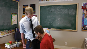 Ravishing twink sucks his teacher on his cozy classroom table